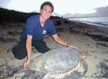 Nathan Robinson with a sea turtle